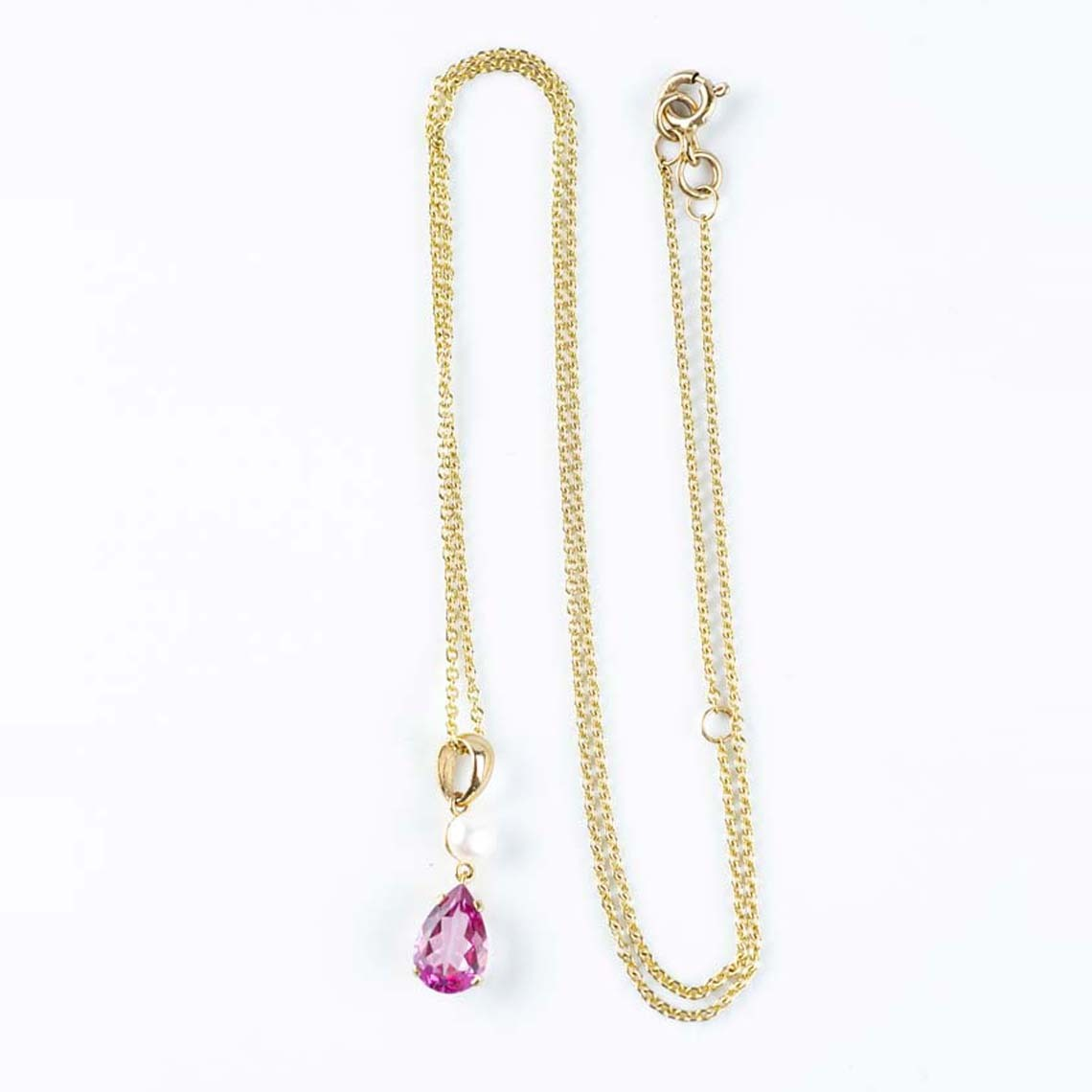 Pink topaz and pearl pendant