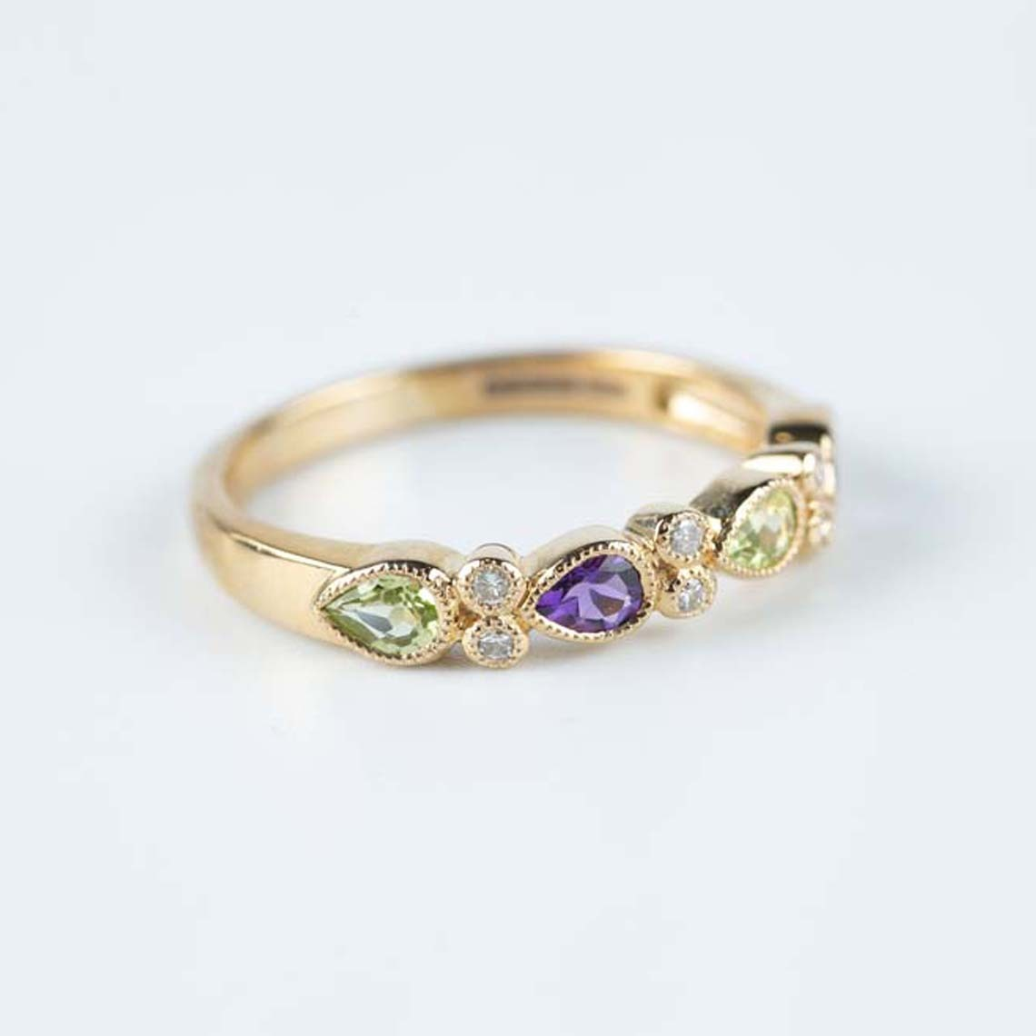 Amethyst, peridot and diamond ring