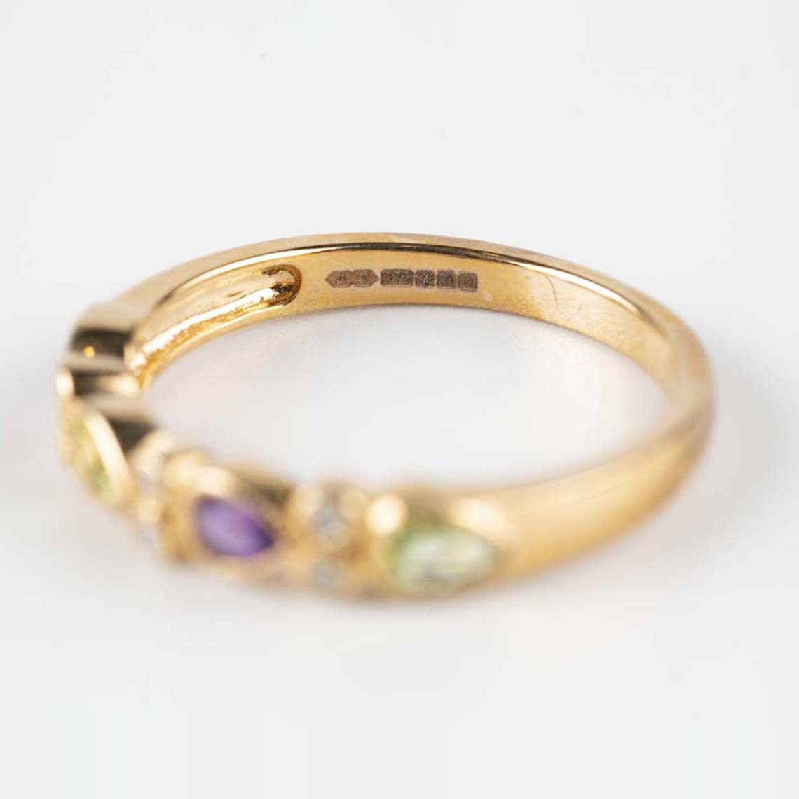 Amethyst, peridot and diamond ring