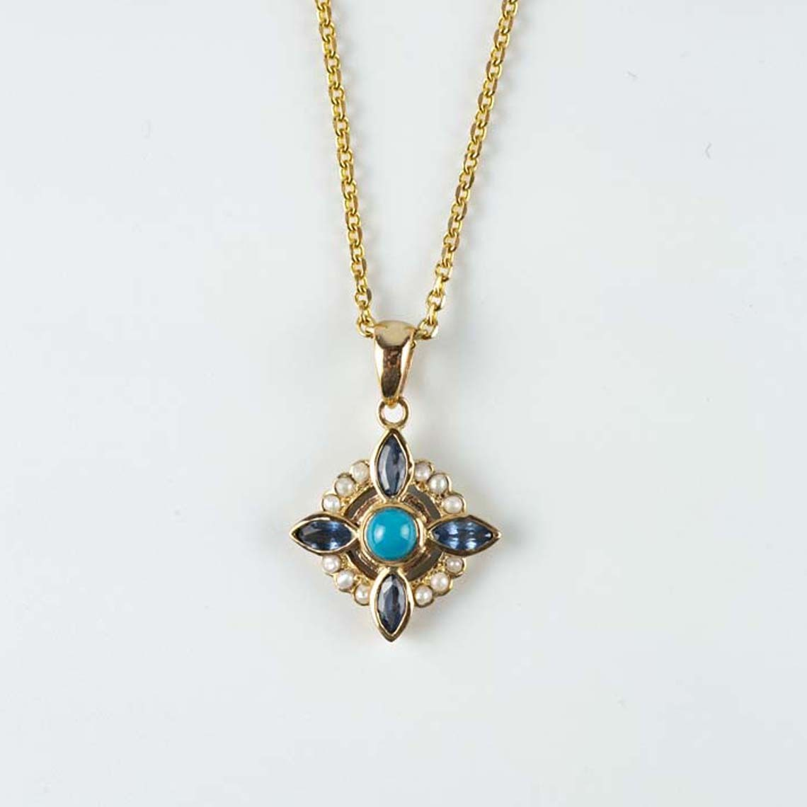 Sapphire, turquoise and pearl pendant