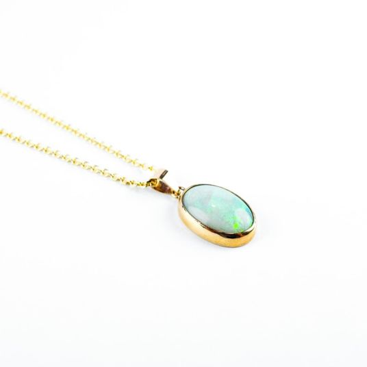 Gold​ and opal Pendant